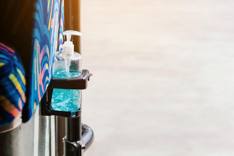 Close-up of sanitizer bottle on rack