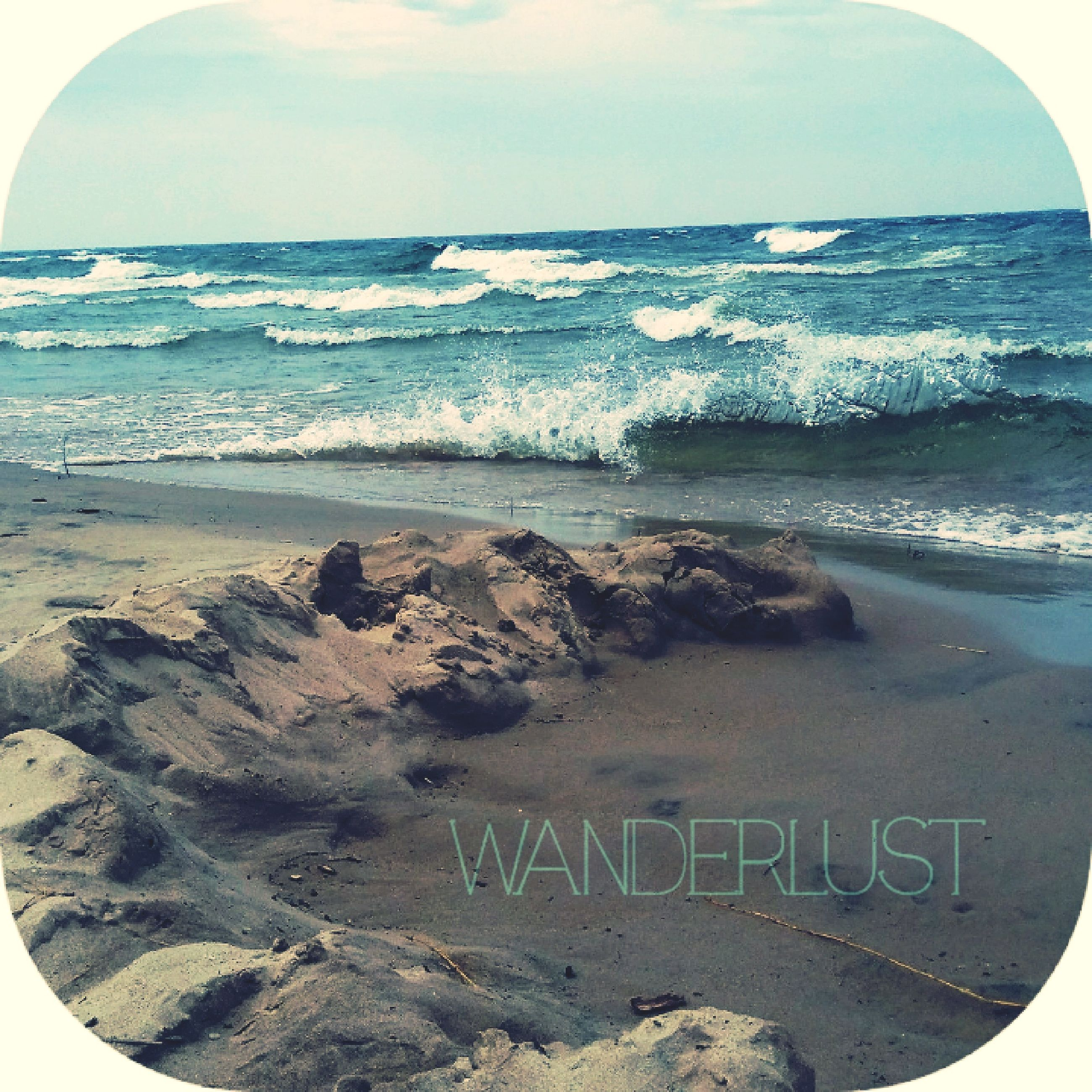 western script, text, communication, sea, horizon over water, beach, nature, sky, no people, scenics, day, beauty in nature, water, sand, outdoors, tranquility, close-up