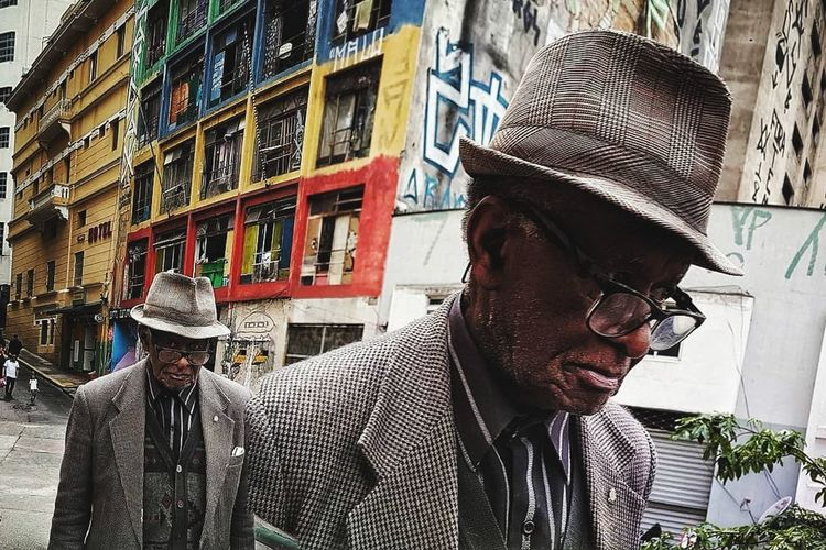 Streetphotography Street Scene Street Headwear Men Headshot City Standing Building Exterior Architecture Flat Cap Thoughtful Wearing Head And Shoulders Multiple Image