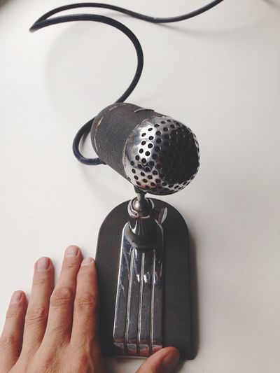 Cropped Man Hand By Microphone On White Desk At Radio Station