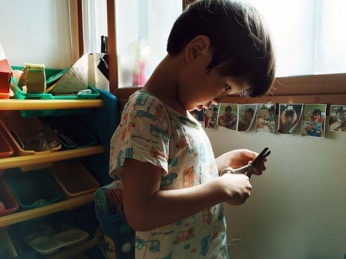 Boy holding scissors