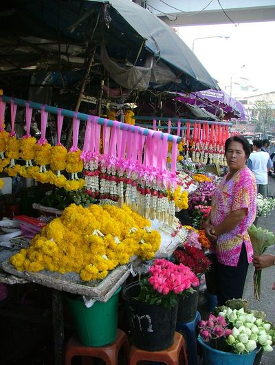 Abundance ASIA Bouquet Flower Flowers Flowerseller. For Sale Many Floral Decorations. Market Market Flowerseller. Market Stall Multi Colored One Person. One Personality. One Heart Small Business Variation Yello Flowers Yellow