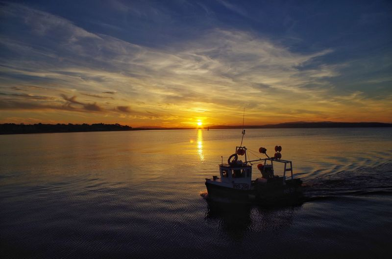 🌅⛵️ Sunset Water Sky Cloud - Sky Nature Scenics Nautical Vessel Sea Beauty In Nature Silhouette Tranquility Reflection Transportation Tranquil Scene Mode Of Transport Outdoors Waterfront Horizon Over Water Sailing Nairn Scotland Visit Scotland Scottish Highlands Boat