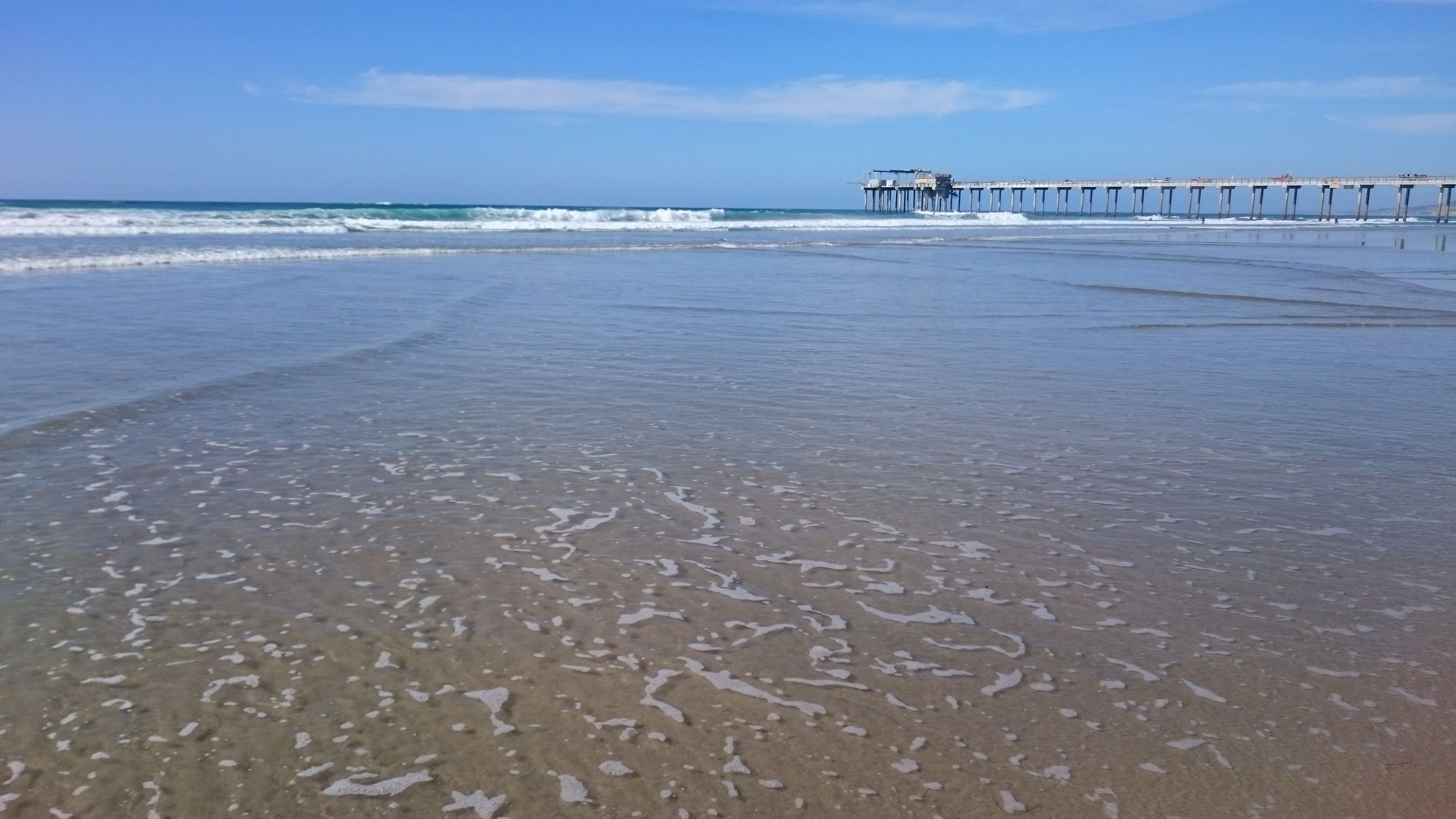 sea, water, horizon over water, beach, sky, tranquility, tranquil scene, shore, scenics, sand, beauty in nature, nature, pier, wave, idyllic, seascape, blue, outdoors, day, ocean