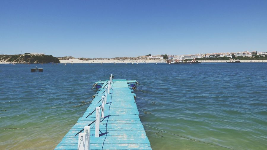 EyeEm Selects Milfontes Praia Das Furnas Pier Outdoors Sky Clear Sky Sea Blue No People Water Beach Nature Day Wooden Structure Wood - Material Blue Color Piers End Nature