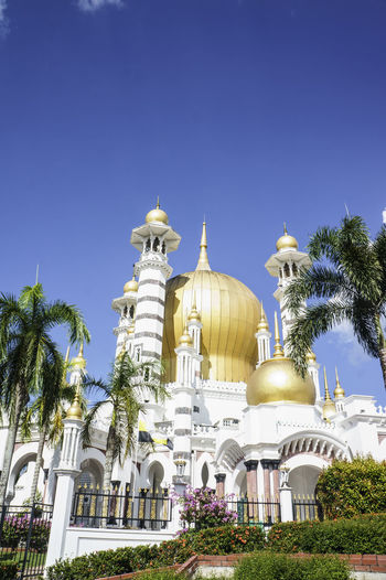 The Ubudiah Mosque Perak Darul Ridzuan, Malaysia Pray Architecture Building Exterior Built Structure Clear Sky Dome Gold Colored Islam Islamic Architecture Low Angle View Muslim No People Palm Tree Praying Religion Spirituality Travel Destinations