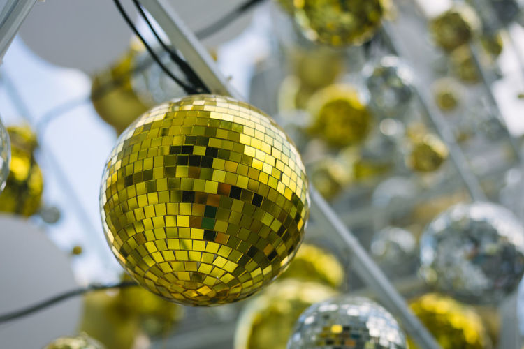 Backgrounds Celebration Christmas Christmas Tree Close-up Day Gold Hanging Low Angle View Nature No People Outdoors White Yellow