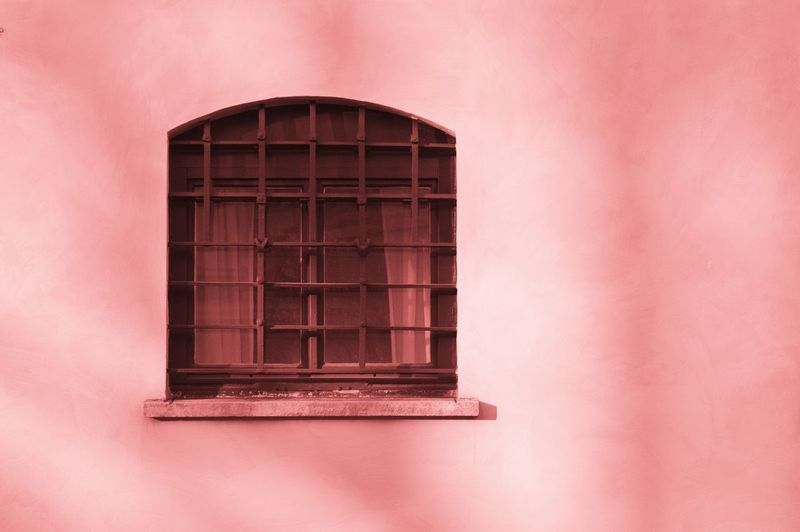 Close-up of pink window on building