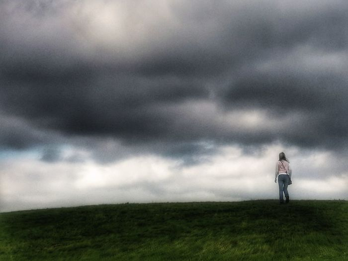 Storm Thunderstorm Storm Cloud Weather Cloud - Sky Grass Field Dramatic Sky One Man Only Walking Full Length Adult People Extreme Weather One Person Sky Adults Only Outdoors Standing Nature Alone On A Hill
