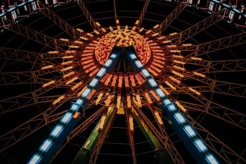 Low angle view of illuminated ferris wheel