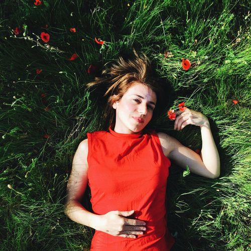 Portrait of cute girl sitting on grass