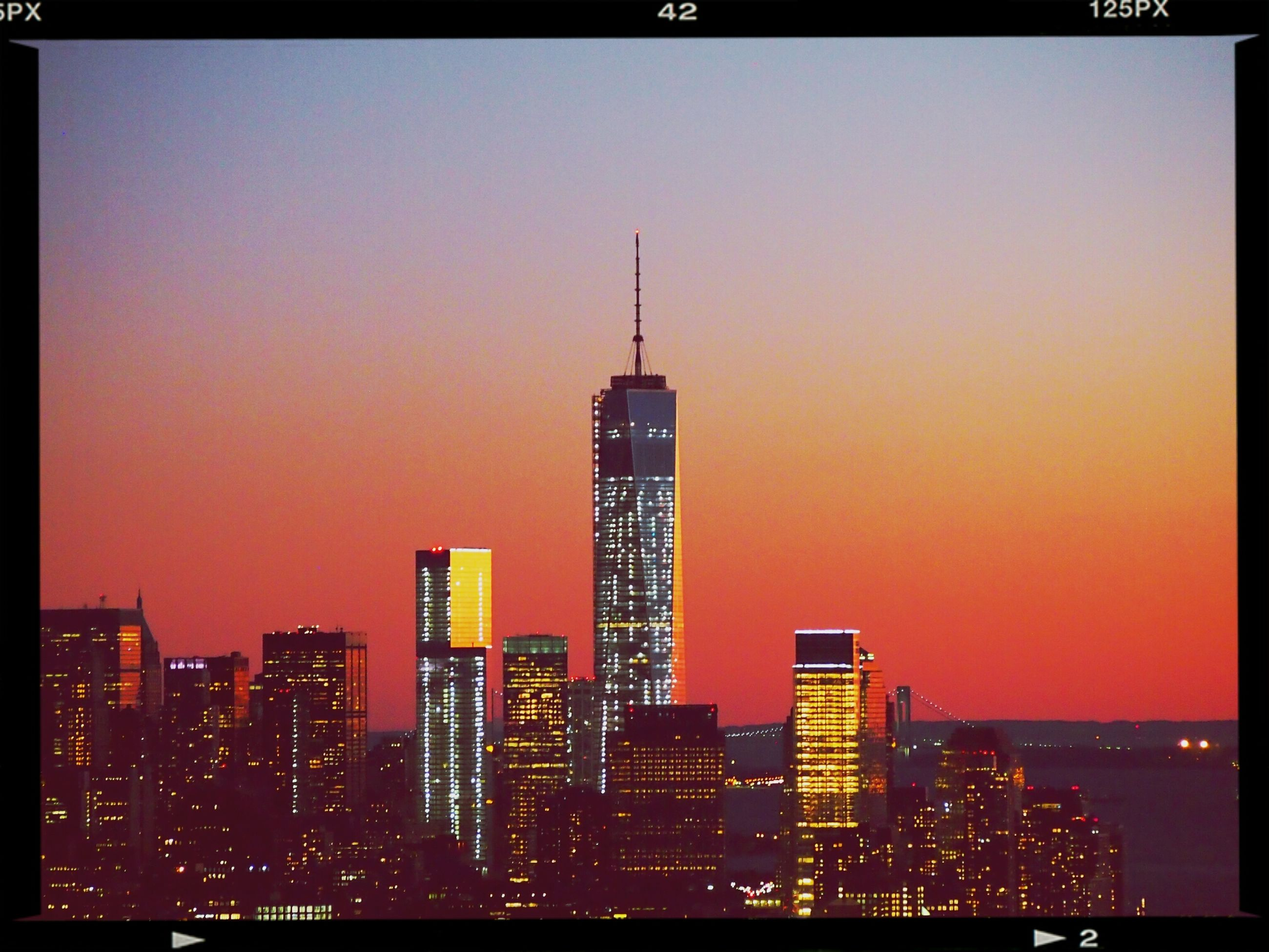 building exterior, architecture, city, skyscraper, built structure, transfer print, cityscape, tower, tall - high, illuminated, modern, clear sky, auto post production filter, office building, copy space, urban skyline, sunset, development, orange color, night