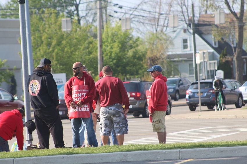 Verizon Wireless workers on strike for fair wages in Cheektowaga NY Buffalo NY Angry Buffalo Ny Cars Cheektowaga NY City Day Leisure Activity Lifestyles Men On Strike Outside People Photojournalist Eyeem 2016 Red Spring Standing Stressed Suburbs Traffic Unfair Wages Union VerizonWireless Walking