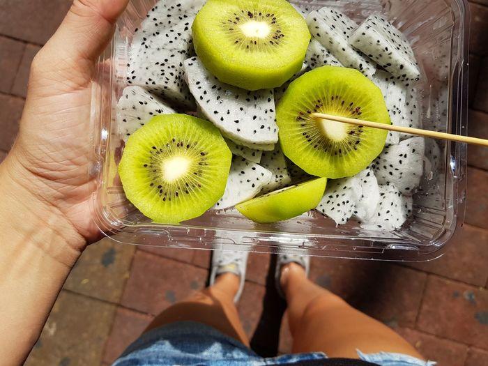 eating fruit Dragonfruit Fruits Cut Fruits Kiwi Vegan Food Vegan Snack Human Hand Low Section Fruit Healthy Lifestyle Women Nail Polish Human Leg Human Foot Close-up Food And Drink