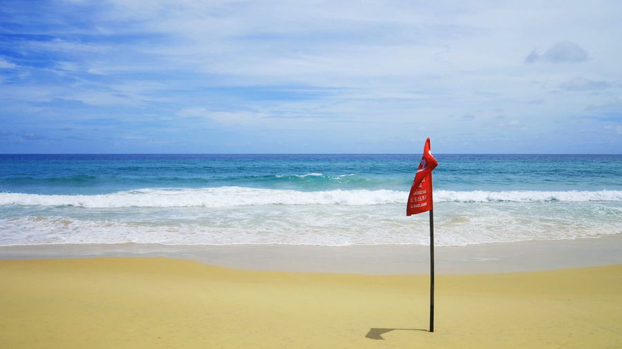 Andaman sea phuket thailand Sea Flag Land Beach Horizon Over Water Horizon Scenics - Nature Water Sky Beauty In Nature Tranquility Day Sand Patriotism Tranquil Scene No People Nature Cloud - Sky Motion Outdoors