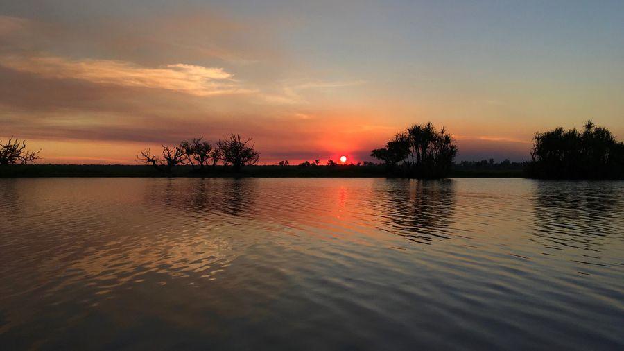 Scenic view of lake against orange sky