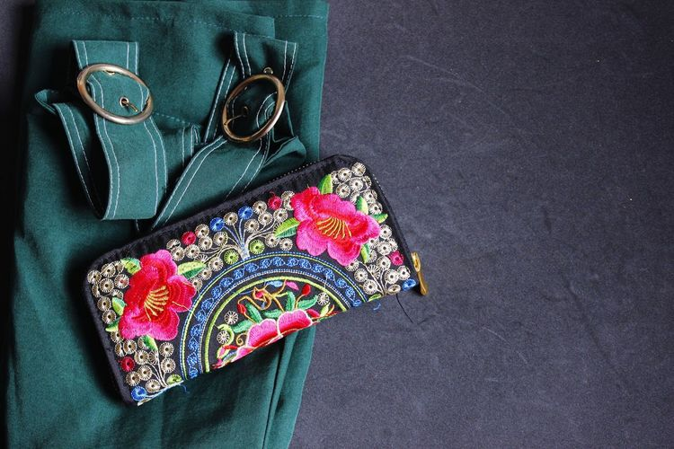 Lets go green this summer Flat Lay Multi Colored Clutch Purse Black Background Text Space Summertime Outfit Smart Casual Chic Trendy Bottle Green Colour Multi Colored High Angle View Table Sequin Textile Fashion Close-up Fabric Personal Accessory Cloth Handmade Clothesline