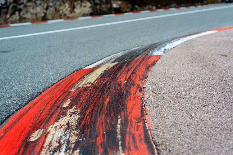Close-up of red marking on road