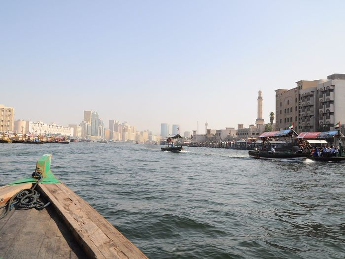 Dec'16: a boat ride across Dubai Creek- Bur Dubai Abra Station (Dubai, UAE) Abra Bur Dubai Dubai Dubai Creek Dubai❤ UAE UAE , Dubai United Arab Emirates Architecture Building Exterior Built Structure City Cityscape Clear Sky Dubaicity Mode Of Transport Nautical Vessel Outdoors Sky Skyscraper Transportation Urban Urban Skyline Water Waterfront EyeEmNewHere Mobility In Mega Cities