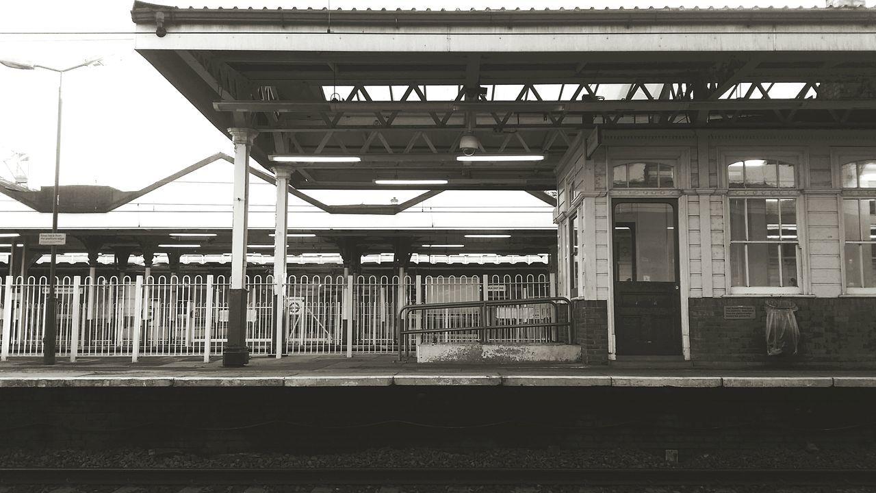 rail transportation, transportation, railroad station platform, railroad station, built structure, railroad track, public transportation, architecture, train - vehicle, no people, day, outdoors