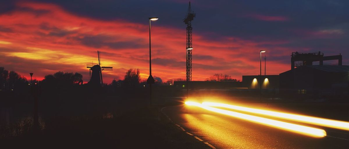 Into the night Long Exposure Night Outdoors Road Silhouette Sky Sunset Trailing Lights Transportation Windmill