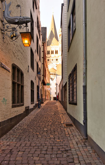 Cologne, GERMANY - February 15, 2019: Historic old town impresses with a small ancient and narrow pathway between historic houses Architecture Building Exterior Built Structure Street Building City The Way Forward Direction Cobblestone Lighting Equipment Footpath No People Residential District Illuminated Outdoors Narrow Diminishing Perspective Window The Past History Alley Paving Stone Electric Lamp