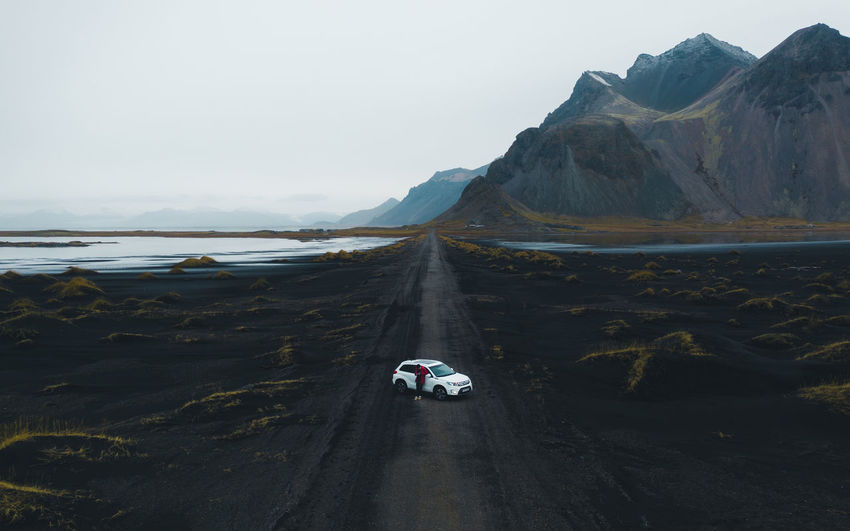 Hi friends! @itchban / itchban.com Transportation Mode Of Transportation Scenics - Nature Mountain Water Road Land Vehicle Sky Nature Beauty In Nature Day Motor Vehicle Travel Non-urban Scene Car Tranquil Scene Tranquility Land Outdoors Iceland Drone