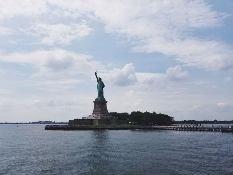 Lady Liberty Statue Female Likeness Travel Destinations Monument Travel History Architecture Patriotism Symbol Water Sculpture TheStatueofLiberty
