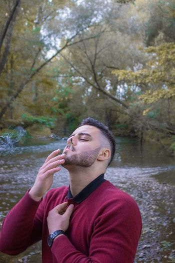 Call this spot Chapo Water One Person Leisure Activity Tree Nature Men Portrait Lake Young Adult Contemplation Adult Facial Hair Headshot Real People Day Beard Lifestyles Plant Outdoors