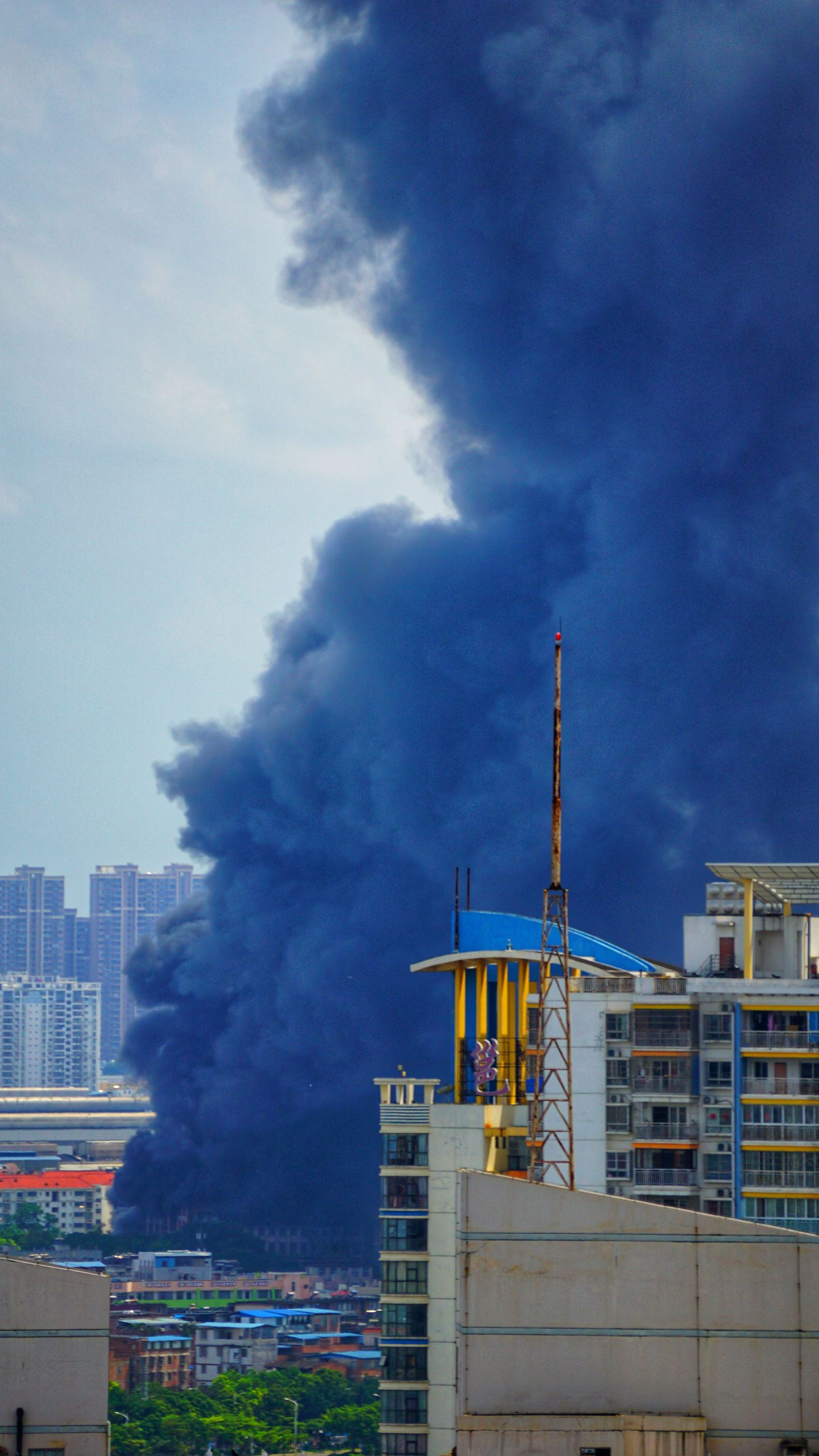 building exterior, architecture, sky, built structure, cloud - sky, smoke - physical structure, industry, city, nature, no people, outdoors, building, day, development, emitting, factory, machinery, construction industry, blue, environmental issues, pollution, office building exterior, air pollution