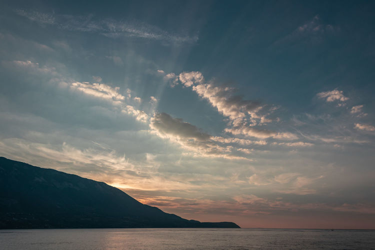 sunrise in kefalonia Sky Cloud - Sky Water Beauty In Nature Sea Scenics - Nature Mountain Tranquility Tranquil Scene Nature Sunset Horizon No People Idyllic Horizon Over Water Waterfront Outdoors Mountain Range