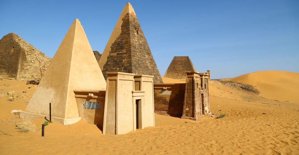 Built structure on desert against sky