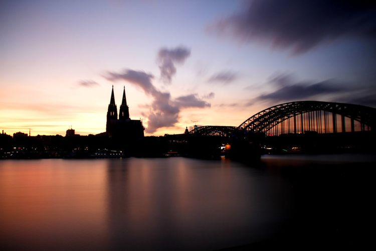 Long Exposure Clouds And Sky EyeEm Selects Tourism Cologne Germany Dom City Cityscape Sunset Water Bridge - Man Made Structure Sky Architecture Cloud - Sky Urban Skyline River Waterfront Bridge Suspension Bridge Riverbank Tall - High Arch Bridge Boat The Architect - 2018 EyeEm Awards #urbanana: The Urban Playground HUAWEI Photo Award: After Dark