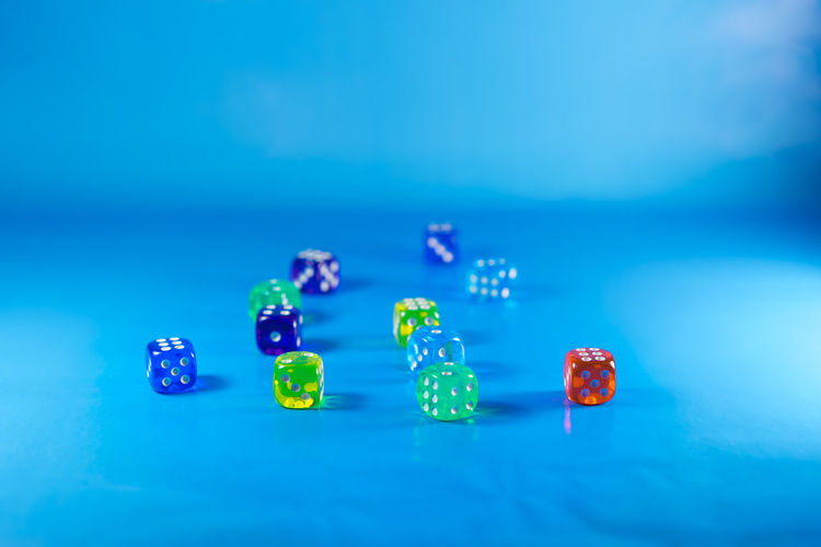 Close-Up Of Dices Over Blue Background