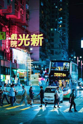 Group of people crossing road in city
