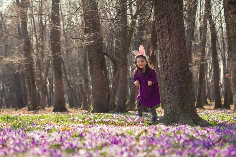 Full length of a smiling girl in forest
