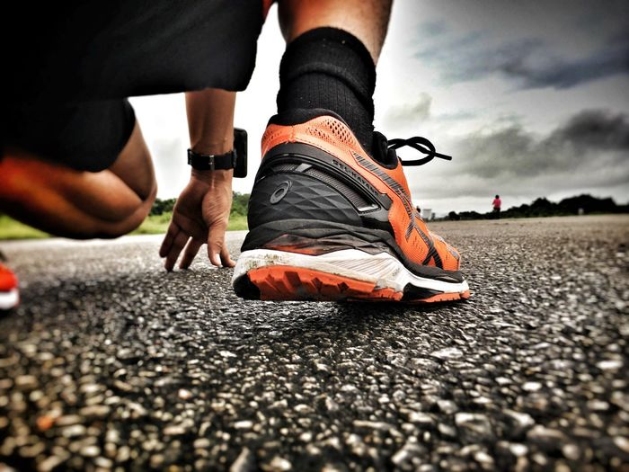Low Section Human Leg Human Body Part Men Street Shoe Real People Road Outdoors Lifestyles Day One Person Sky Only Men Close-up Adult Begin People Run Runner Sport Exercise Athletic Speed Start