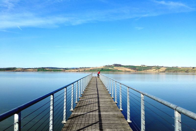 Lago di Vico Relaxing Lake Italy Huaweiphotography HuaweiMate7 Capture Tomorrow Water Full Length Footbridge Clear Sky Lake Blue Bridge - Man Made Structure Jetty Pier Railing Calm