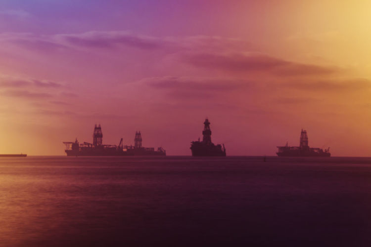 Sky Sunset Cloud - Sky Water Sea Nature Architecture Built Structure Oil Industry No People Building Exterior Fuel And Power Generation Silhouette Dusk Industry Environment Orange Color Fog
