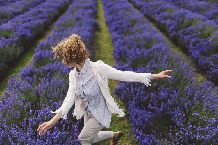 Cheerful Of Woman Dancing On Lavender Field