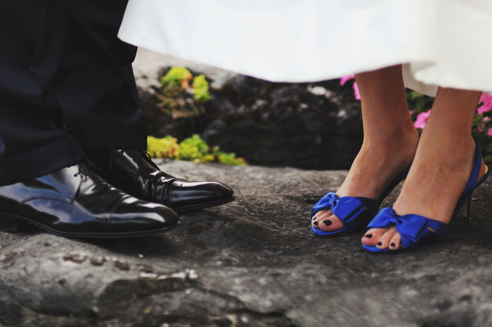 The Bride and Groom Anonymous Black Tie Bride Bride And Groom Casual Clothing Close-up Copyspace Couple Day Focus On Foreground Footwear Formal Groom Horizontal Human Foot Lifestyles Low Section Marriage  Person Selective Focus Shoes Something Blue Wedding Wedding Party Wedding Photography