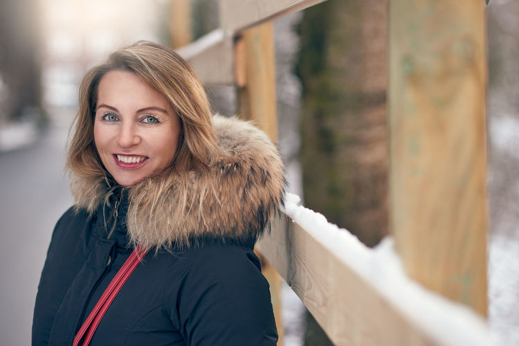 Portrait of smiling mature woman wearing warm clothing during winter