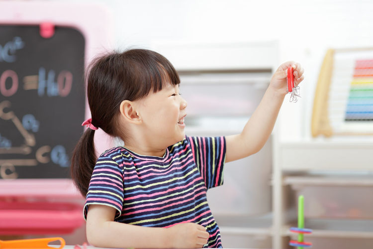 Young girl playing science experiment at home