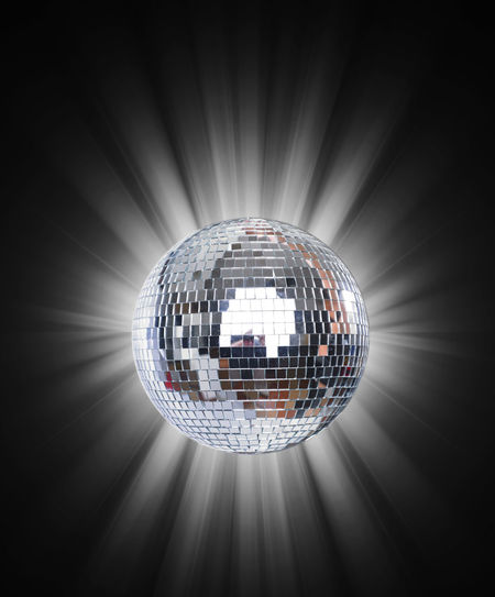 Illuminated disco ball hanging from ceiling