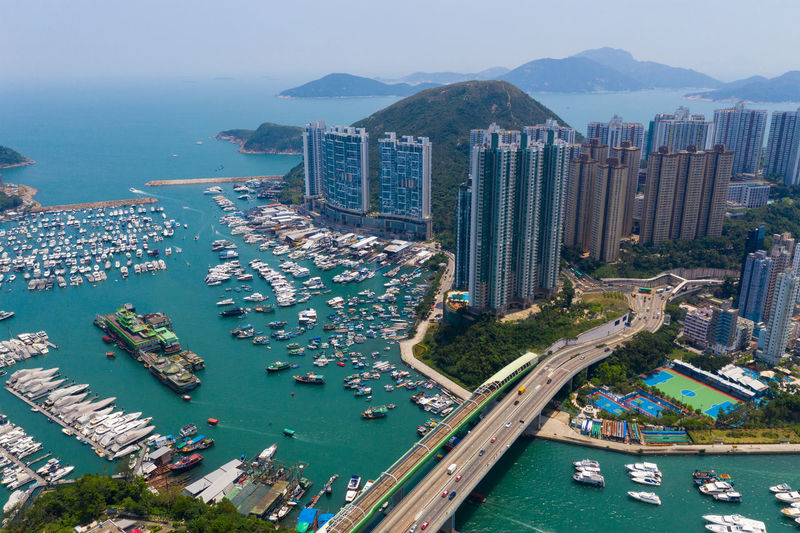 Top view of Hong Kong city Hong Kong Top View Building Aberdeen Harbor Port Fish Boat Ship Sea Seascape Ocean Bay Water Typhoon Shelter Ap Lei Chau City Aerial Road Urban Town Architecture Tower Traffic Office Downtown Infrastructure Sky Business Cityscape Corporate Fly Drone  Over Above Down Top Down Bird Eye Hk Hong Kong
