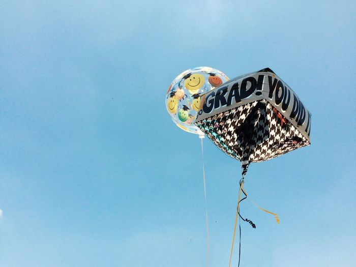 Low Angle View Of Helium Balloons Against Clear Sky