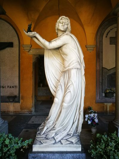 Statue of angel outside building