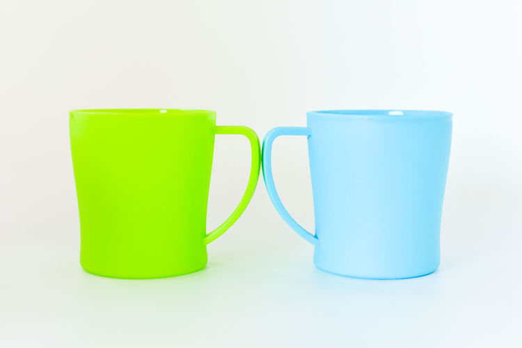 Close-up of empty glasses against white background