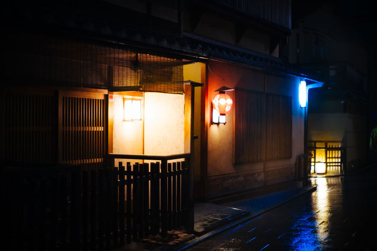 Illuminated building by street light at night