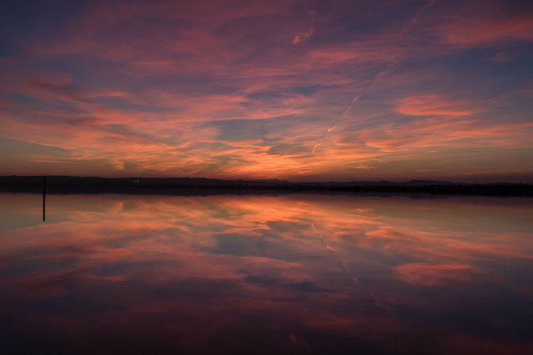 Natural Sunset reflection EyeEmNewHere Day Symmetry Outdoors Idyllic No People Majestic Cloud - Sky Lake Water Sky Tranquility Tranquil Scene Scenics Nature Sunset Beauty In Nature Reflection A New Perspective On Life